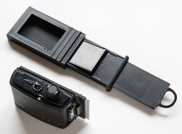 Grafmatic and 120 roll film adapter by Graflex